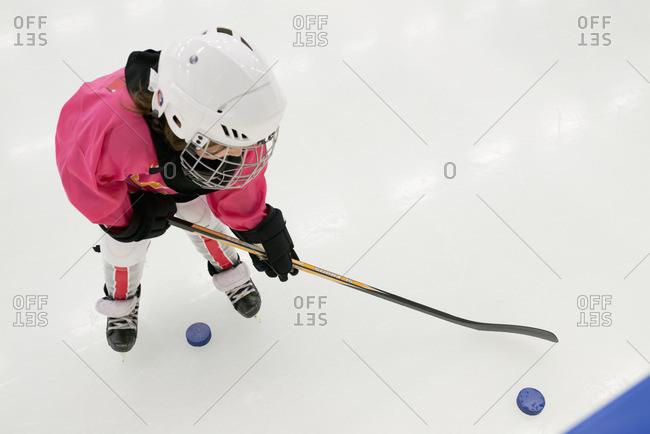 Sweden, Girl training on ice hockey rink