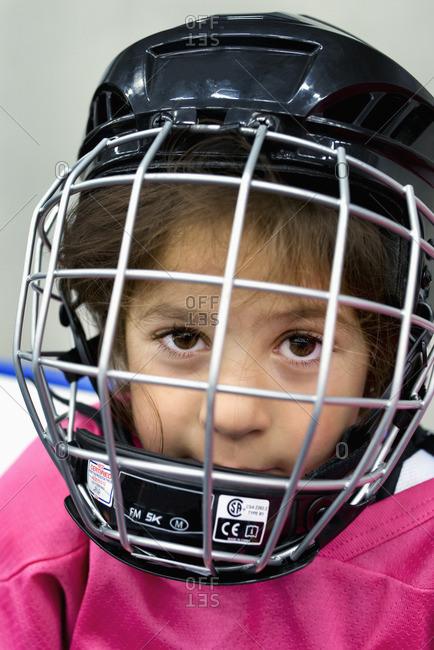 Sweden, Portrait of girl in ice hockey uniform