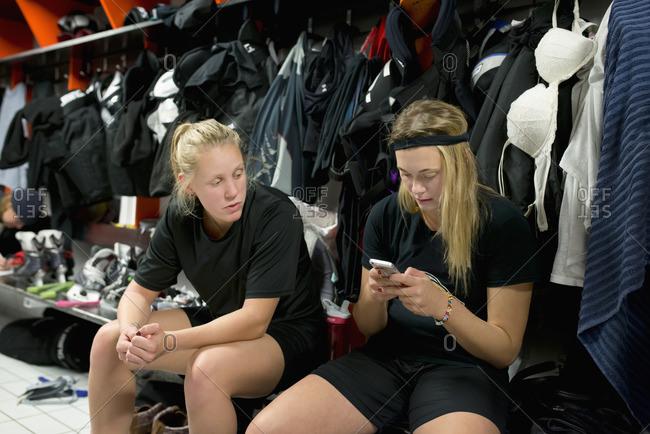 Sweden, Female ice hockey players sitting in locker room
