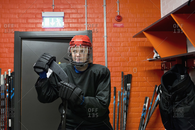 Sweden, Dressed hockey player in locker room