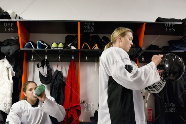 Sweden, Two young hockey players getting ready in locker room