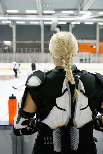 Sweden, Young ice hockey player standing by ice rink