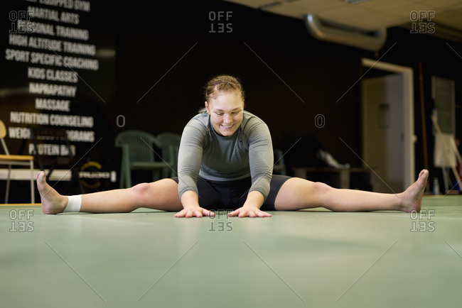 Sweden, Young female boxer stretching