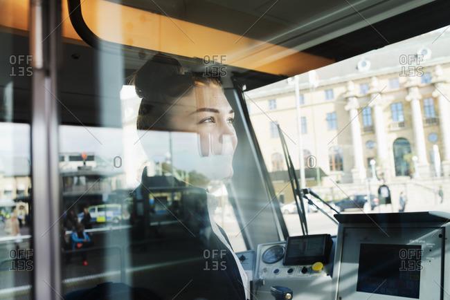 Sweden, Vastra Gotaland, Female tram driver seen through window
