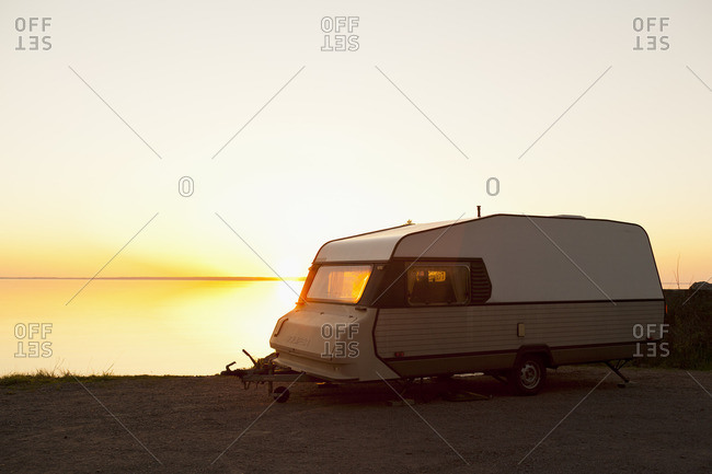 Sweden, Ostergotland, Camoing trailer at lake