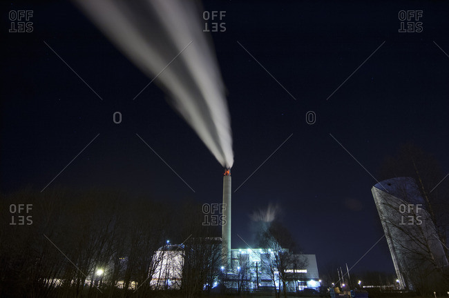 Sweden, Sodermanland, Nykoping, Long exposure of smoke coming from chimney of local power station