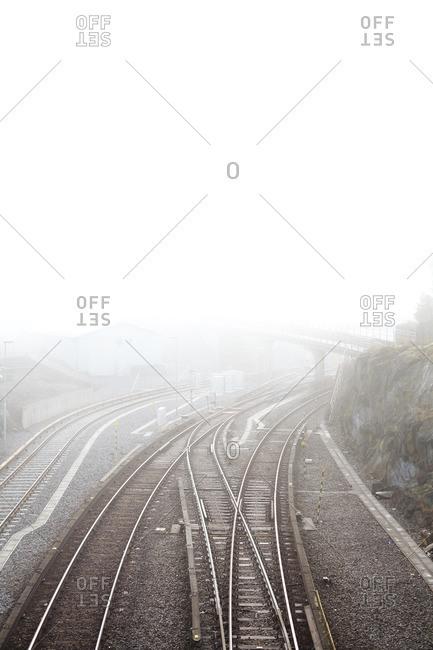 Sweden, Stockholm, Johanneshov, Skarmabrink, Elevated view of railroad track in fog