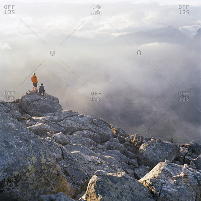 Norway, More og Romsdal, Sunnmore, Hikers on Dalsnibba summit with Geiranger valley in background