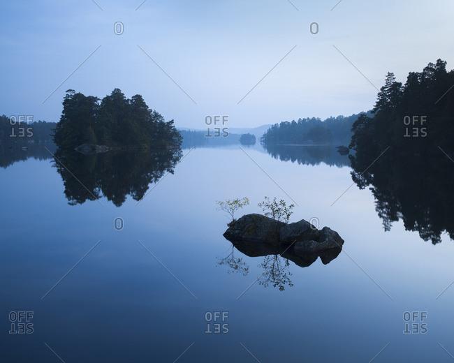 Sweden, Blekinge, Dusk over Lake Halen