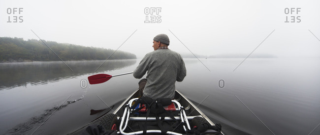 Sweden, Blekinge, Lake Halen, Man rowing on lake