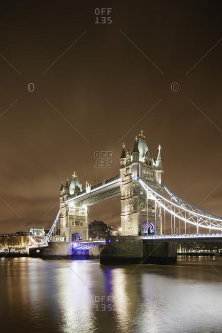 UK, England, London, Illuminated Tower Bridge over Thames River at night