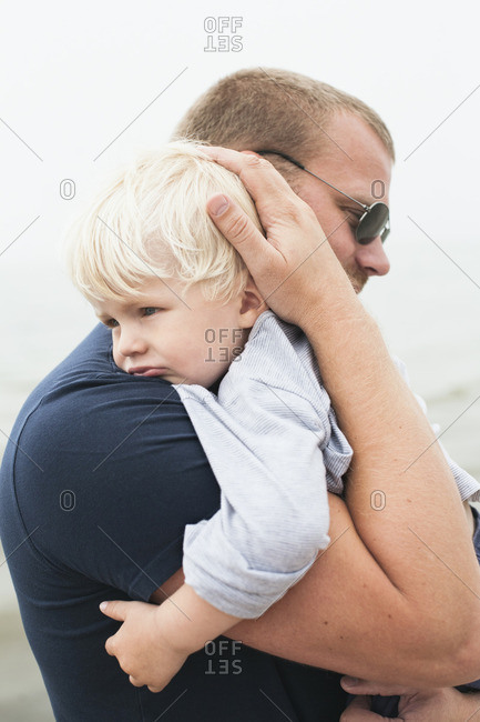 Sweden, Gotland, Ljugarn, Man embracing boy