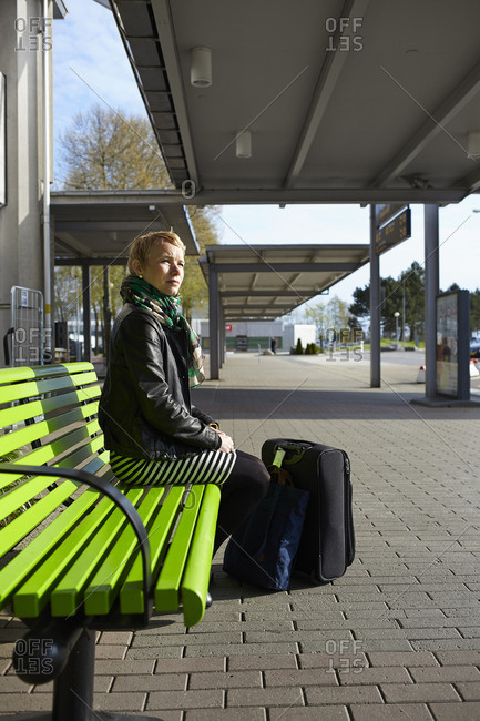Sweden, Harryda, Landvetter, Woman sitting on bench at the airport