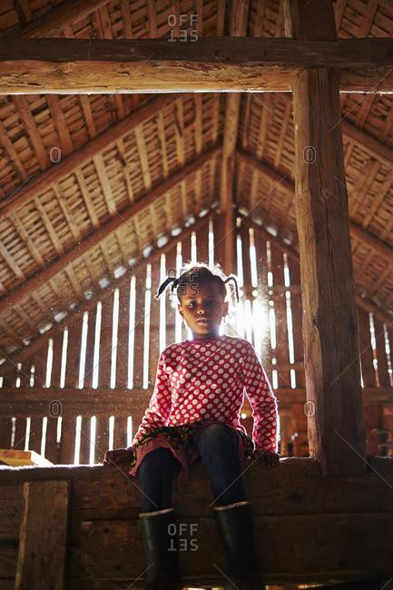 Sweden, Vastra Gotaland, Gullspang, Runnas, Girl sitting in barn