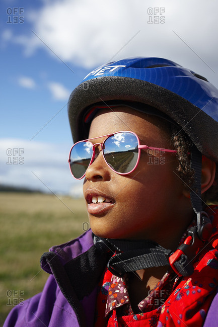 Sweden, Vastra Gotaland, Gullspang, Runnas, Portrait of girl in cycling helmet and sunglasses