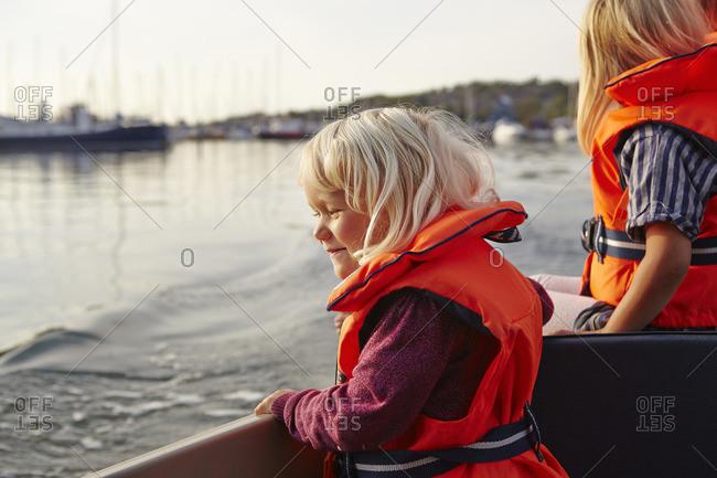 Sweden, Swedish West Coast, Vastra Gotaland, Two girls on tour boat