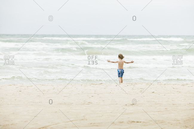 Denmark, Vendsyssel, Jutland, Lokken, Boy standing on beach