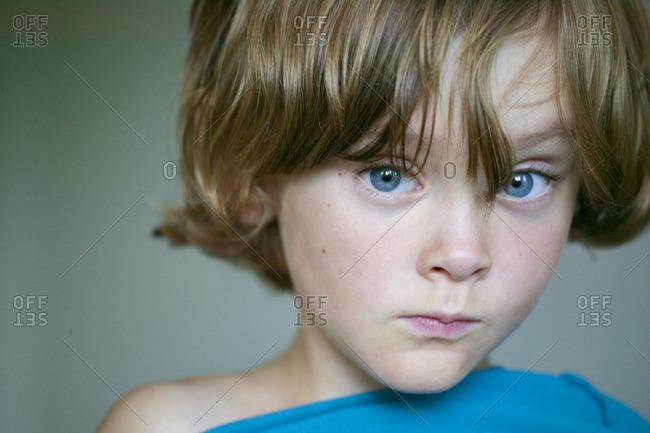 Sweden, Vastergotland, Lerum, Portrait of blue eyed boy