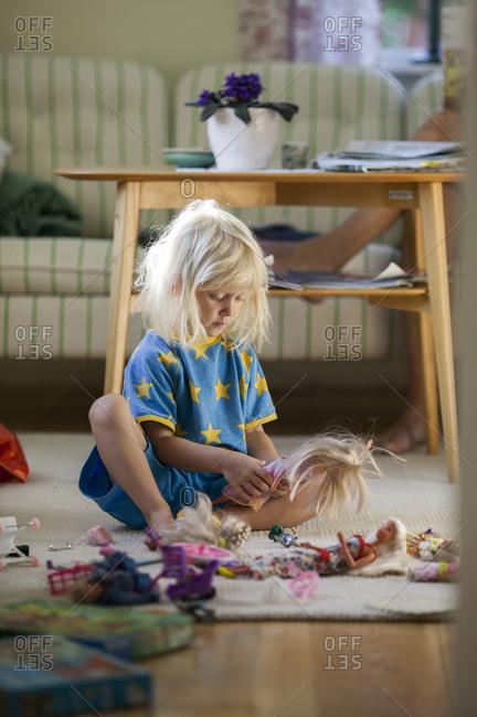 Sweden, Narke, Filipshyttan, Girl playing with dolls