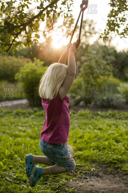 Sweden, Skane, Osterlen, Girl swinging