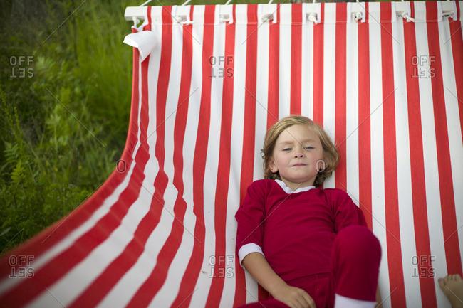 Sweden, Dalarna, Leksand, Boy in hammock