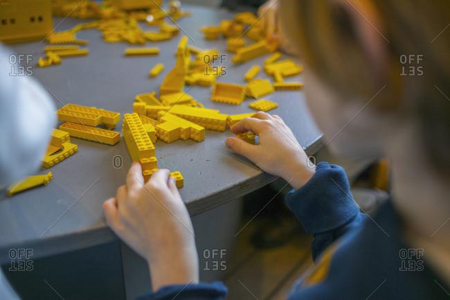 Sweden, Vastergotland, Lerum, Boy playing with toy blocks