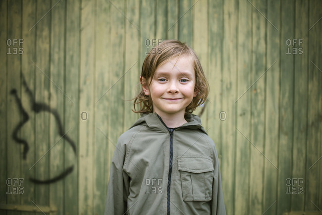 Sweden, Vastergotland, Jonsered, Portrait of boy in backyard