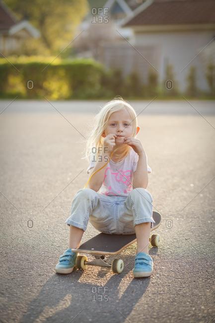 Sweden, Vastergotland, Lerum, Portrait of girl on skateboard