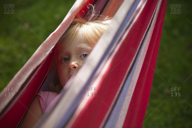 Lerum, Vastergotland, Sweden, Girl hidden in hammock