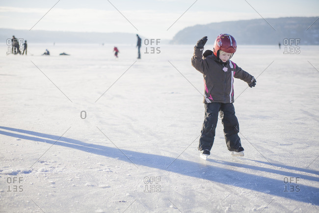 Sweden, Vastergotland, Lerum, Lake Aspen, Girl learning how to ice skate on lake