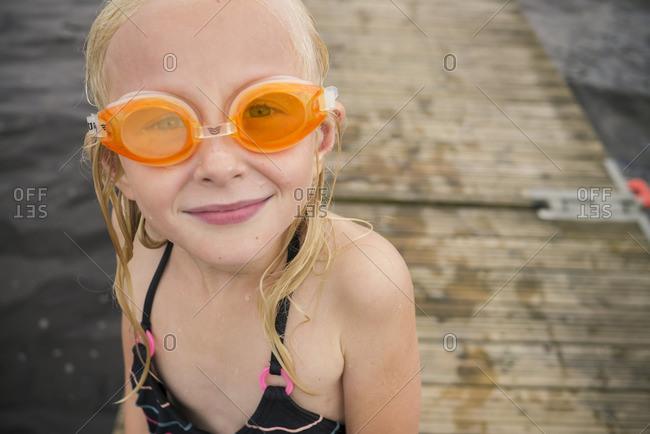 Sweden, Vastergotland, Lerum, Portrait of girl wearing swimming goggles