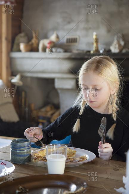 Norway, Girl eating pancakes for breakfast