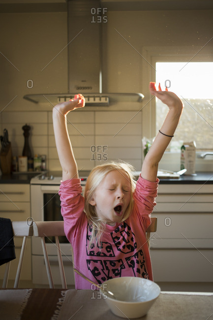 Sweden, Girl yawning at table