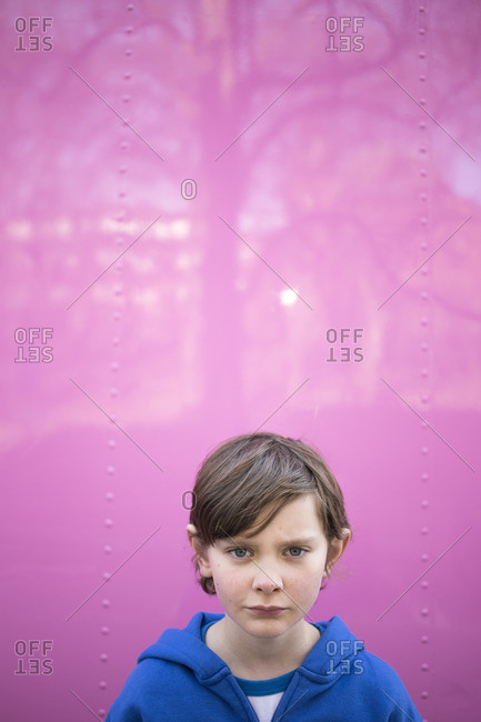 Sweden, Portrait of Boy against pink wall