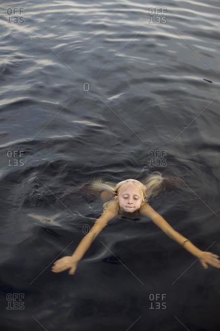 Sweden, Smaland, Braarpasjon, Girl swimming in lake