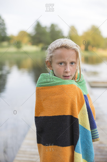 Sweden, Smaland, Braarpasjon, Portrait of girl wrapped in towel after swimming in lake