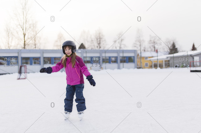 Sweden, Vasterbotten, Umea, Girl ice-skating in winter