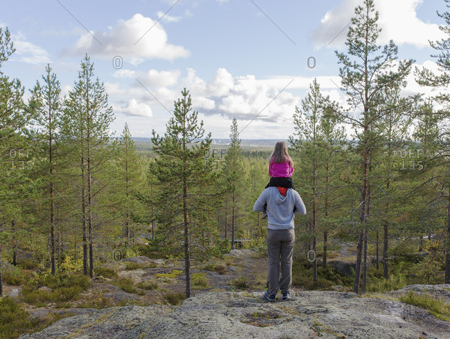 Sweden, Vasterbotten, Umea, Rear view of father carrying daughter on shoulders