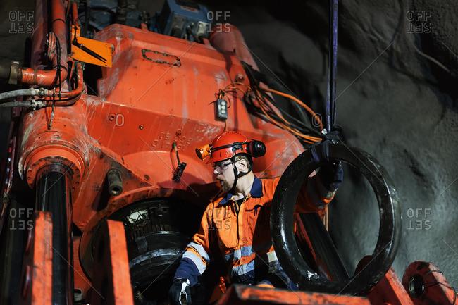 Sweden, Norrbotten, Kiruna, Miner working underground