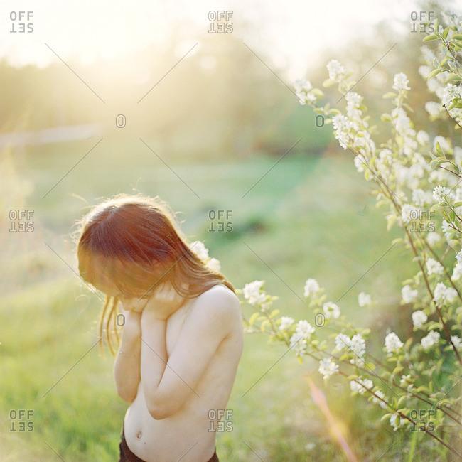 Sweden, Vastmanland, Shirtless girl outdoors in summer