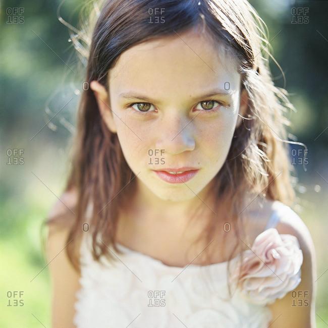Sweden, Vastmanland, Girl looking at camera