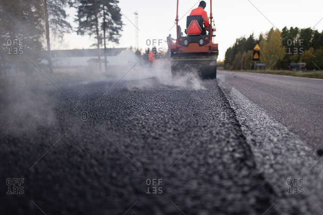 Sweden, Narke, Two manual workers repairing road