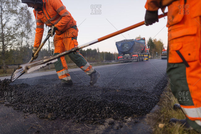 Sweden, Narke, Three manual workers repairing road