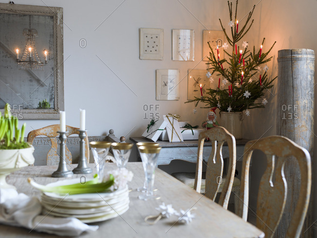 Sweden, Elegant dining table and Christmas tree in living room