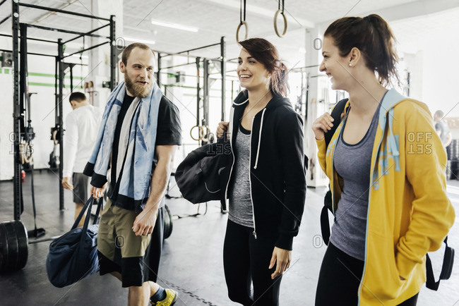 Germany, Young women and man in gym