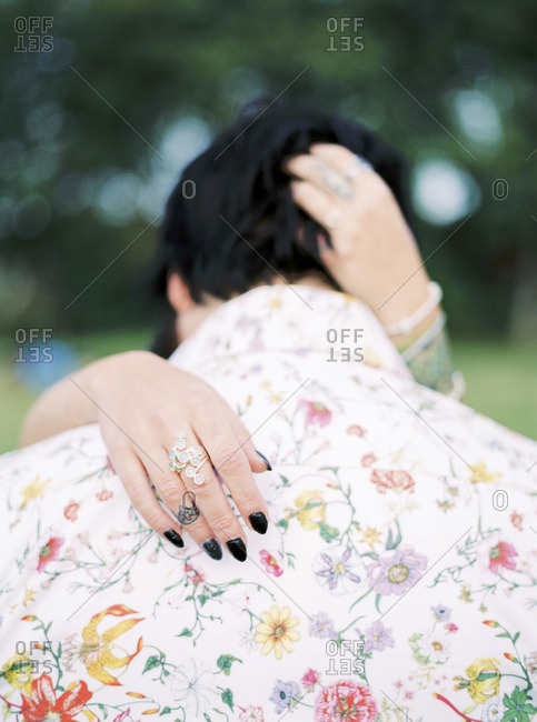 Sweden, Bride and groom in shirt with floral pattern at hippie wedding