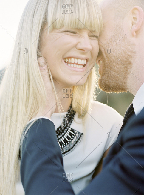 Sweden, Groom kissing bride's cheek