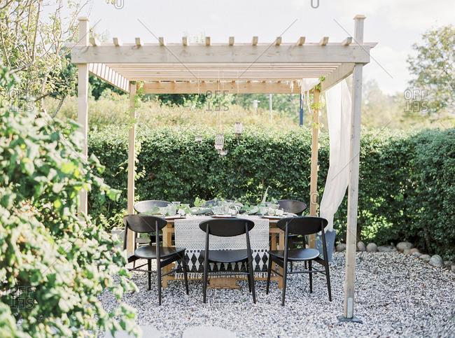 Sweden, Table under gazebo in garden