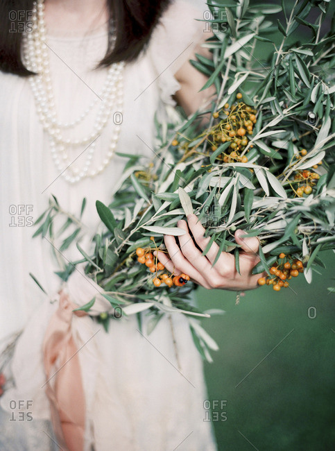 Italy, Elegant woman holding bouquet