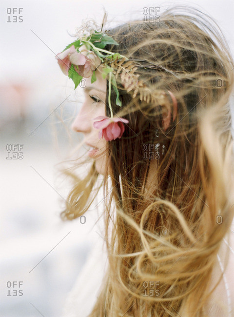 Sweden, Holland, Varberg, Profile of young woman with flowers in hair